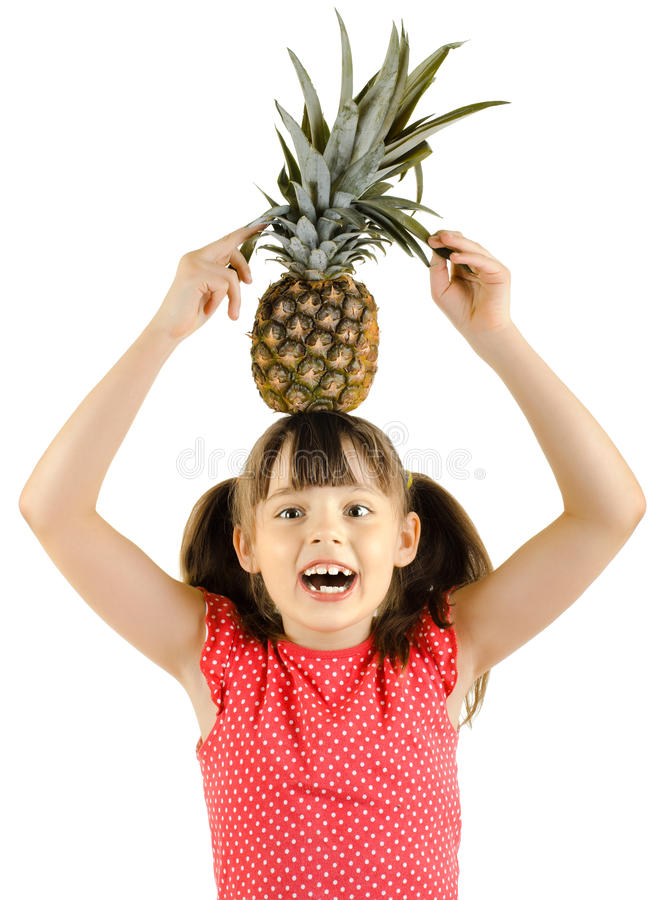 Little girl. Beauty little girl hold big pineapple and smile, on white background, isolated royalty free stock photography