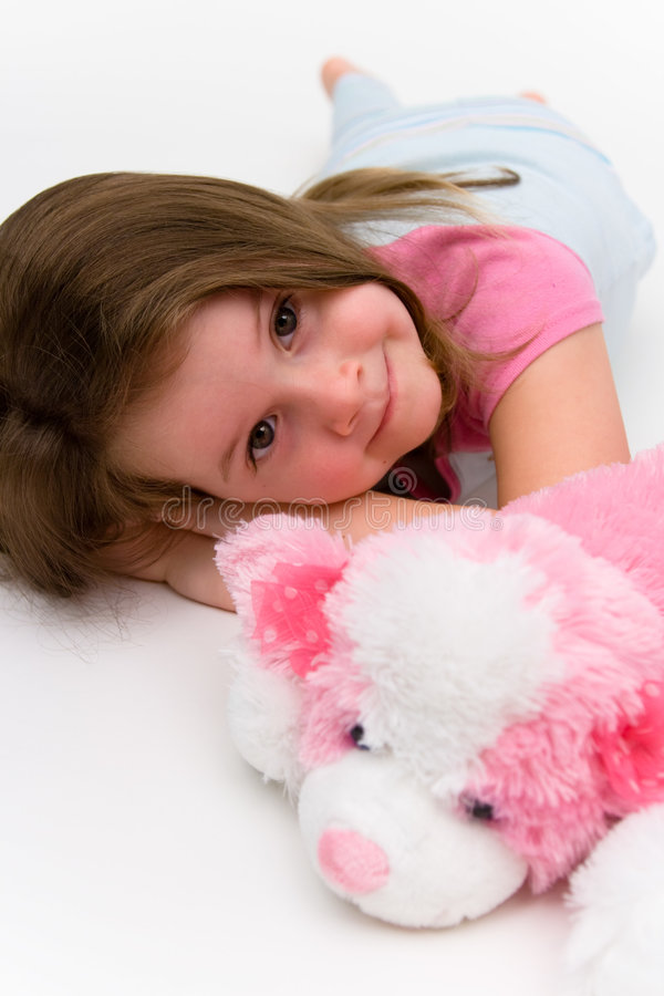Little girl. With pink puppy royalty free stock photo