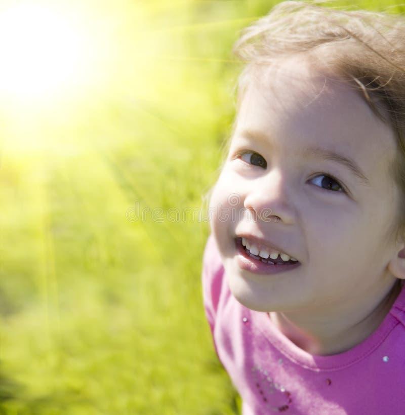 Little girl. Cute little girl and bright summer sun royalty free stock photos