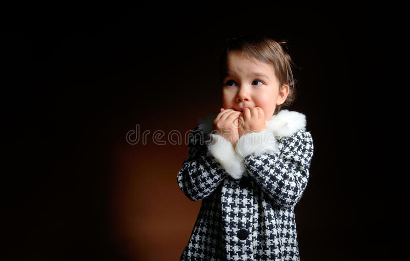 Little girl is afraid. In darkness stock images