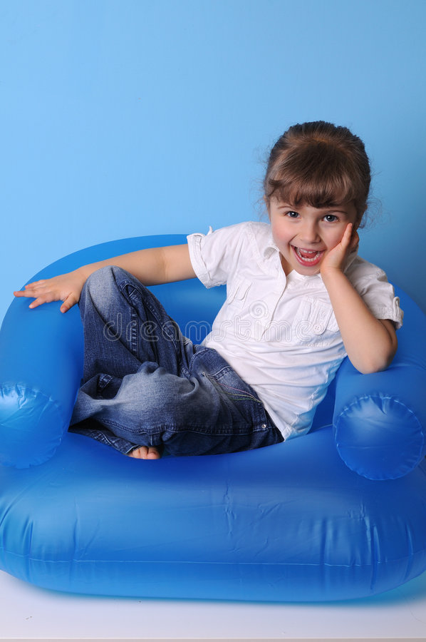 Download Little Girl On Air Armchair Stock Photo - Image of blowed, girl: 4746144
