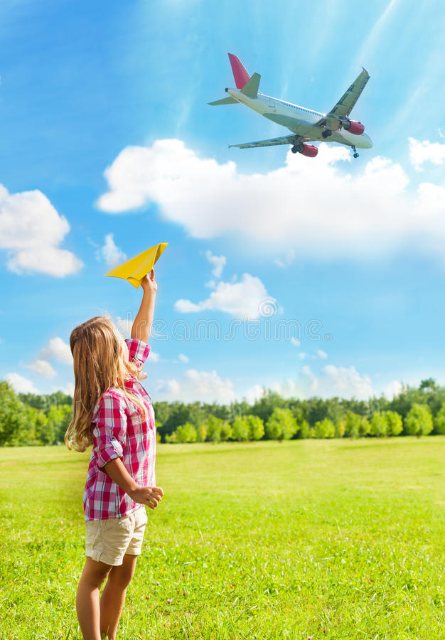 Little girl and airplanes near airport royalty free stock images