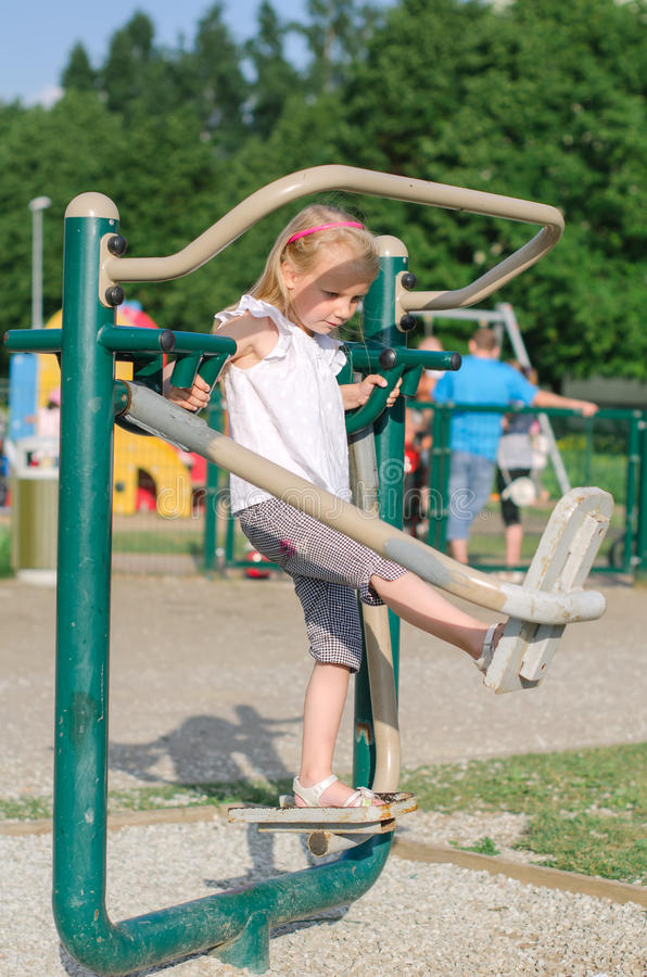 Little Girl In Amusement Park Stock Photo