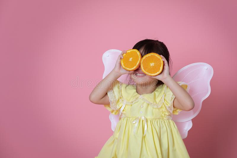 Little girl in angel dress with white wing playing royalty free stock photos