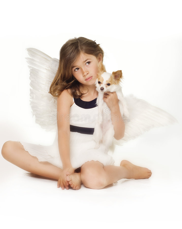 Little girl with angel wings stock images