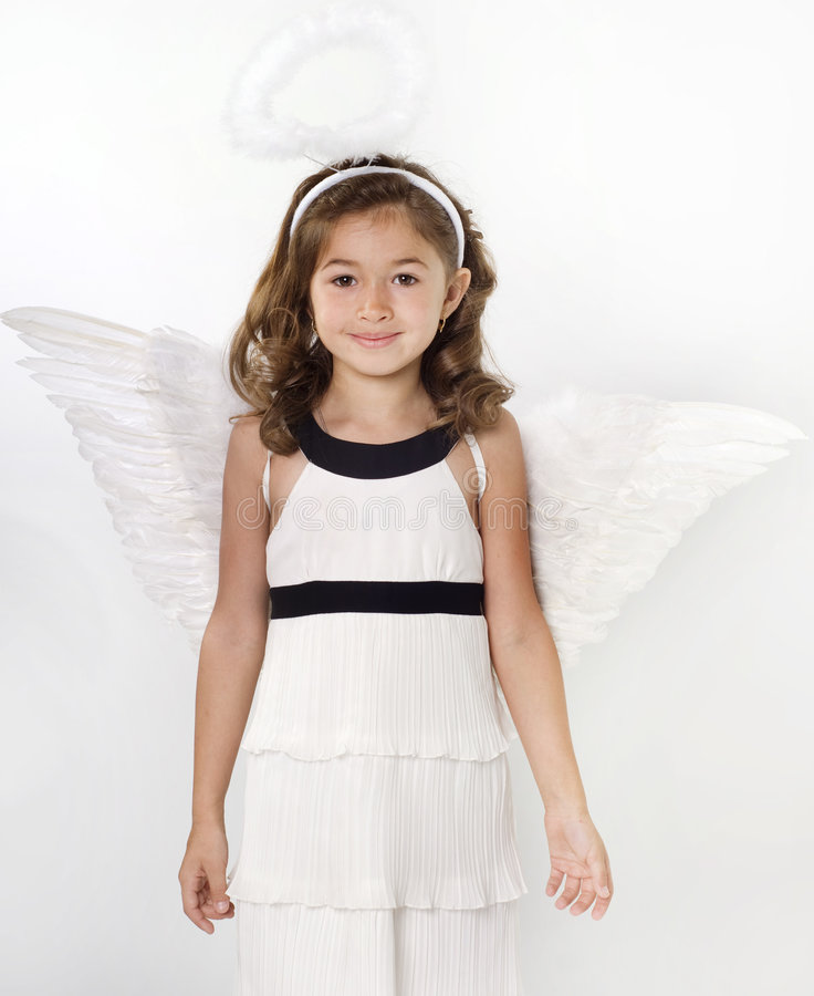 Little girl with angel wings. Angelic little girl with angel wings and halo stock images