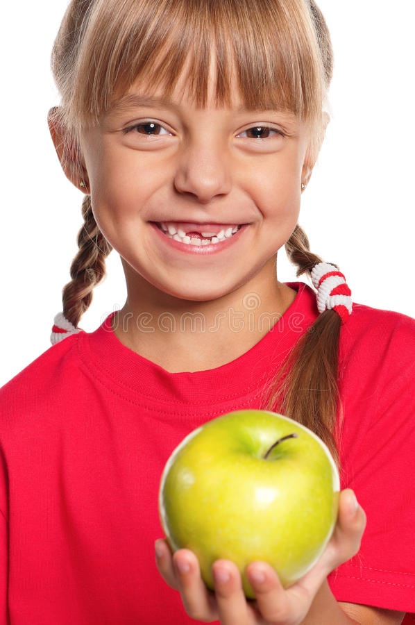 Little Girl With Apple Royalty Free Stock Photos