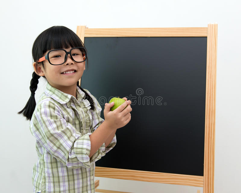 Little girl with apple in hand royalty free stock images