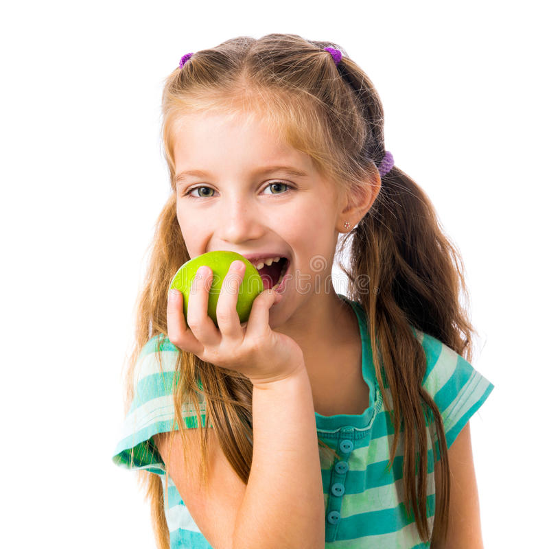 Little girl with apples royalty free stock photos
