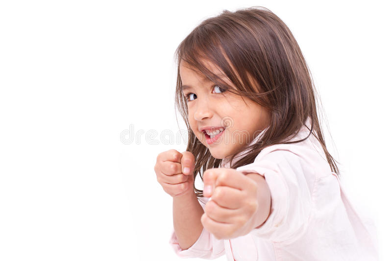 Little girl assuming stance, practicing martial arts stock photography