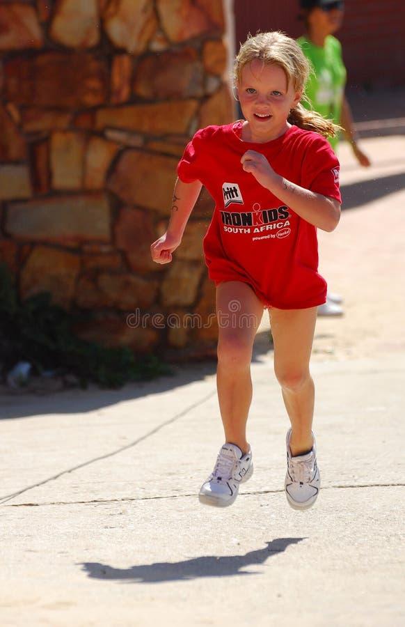 Little girl athlete running royalty free stock image