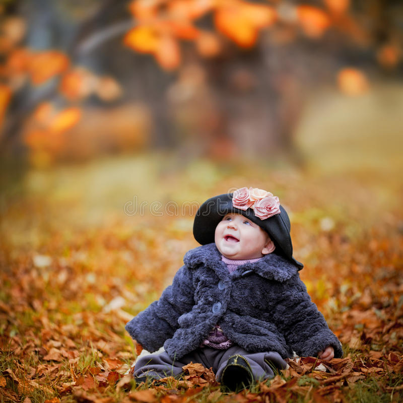 Download Little girl in autumn park stock photo. Image of autumn - 26825202