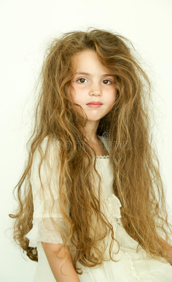 Little girl with bad hair. Beautiful little girl with messy hair stock images