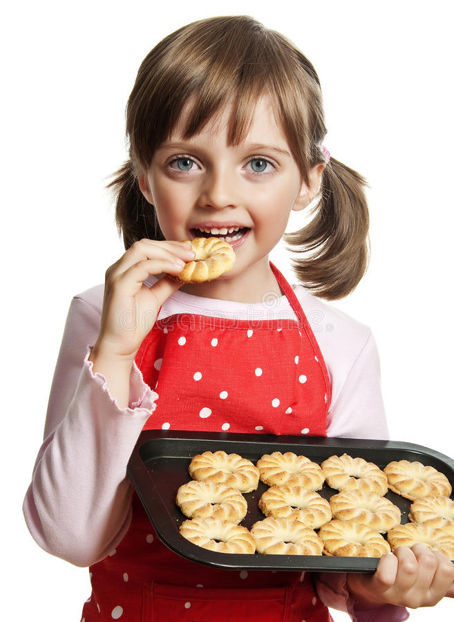Little girl baking Christmas cookies. White background royalty free stock images