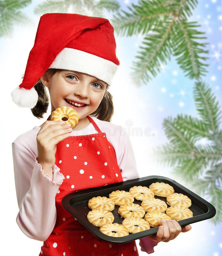 Little girl baking Christmas cookies. Christmas background royalty free stock photos