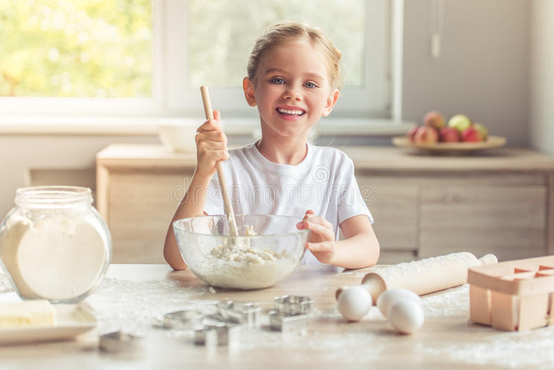 Little girl baking royalty free stock image