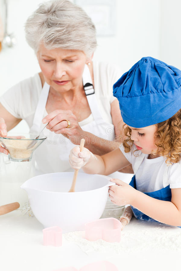 Download A Little Girl  Baking With Her Grandmother Stock Image - Image: 18109263
