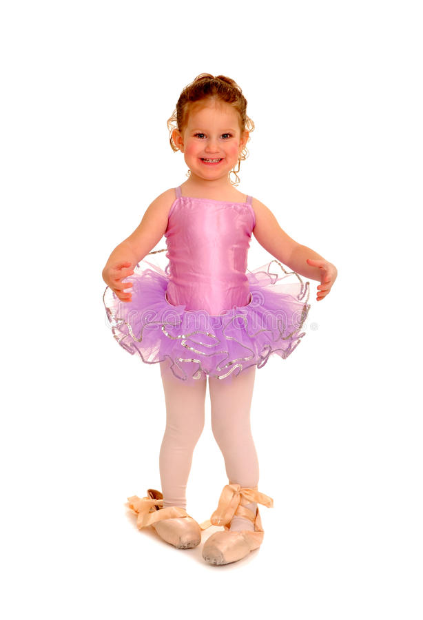 Little Girl Ballerina in Pointe Shoes. Cute Little Girl Wears a Ballet Tutu and Large Pointe Shoes stock image