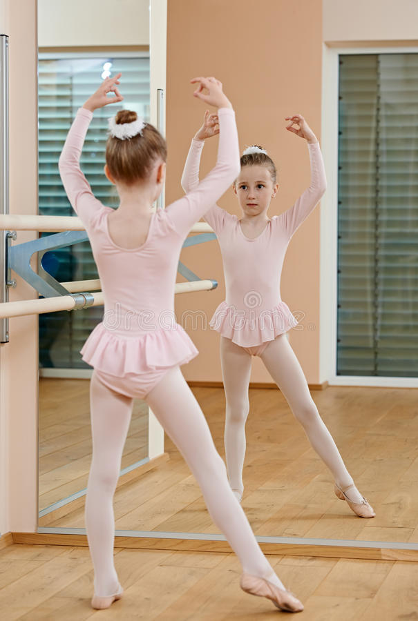Little girl at ballet training royalty free stock photography