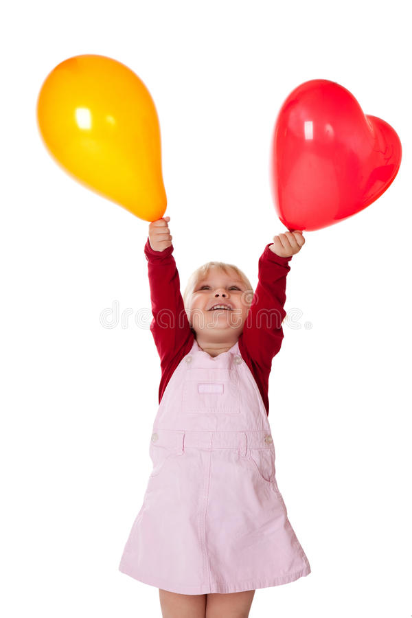 Little girl with balloons royalty free stock photo