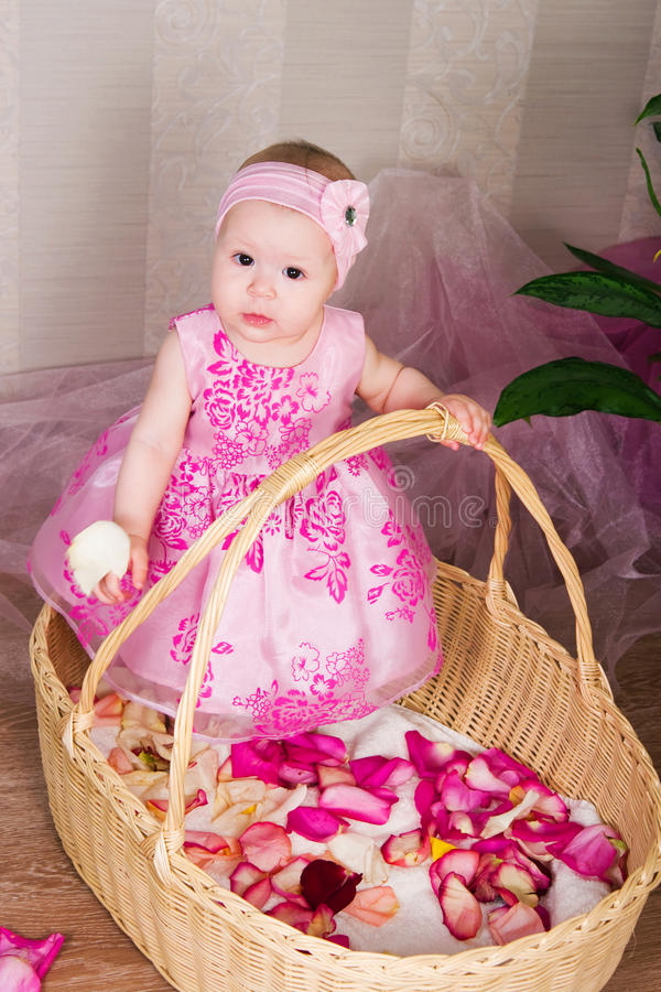 Download The Little Girl In A Basket Stock Photos - Image: 25632243