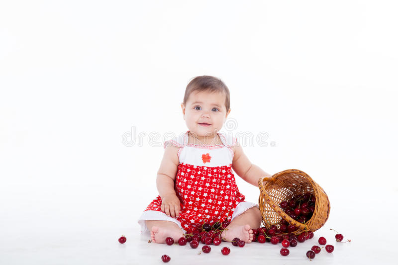 Little girl with a basket of cherries berries royalty free stock photos