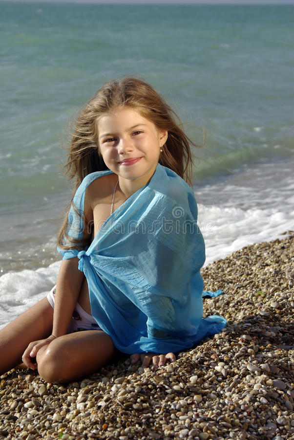 Portrait Of Young Girl On Beach High-Res Stock Photo