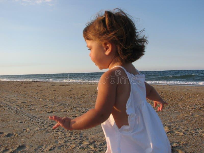 Little girl on beach stock photography