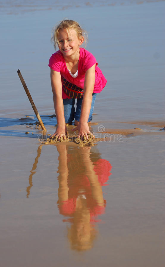 Little girl on beach royalty free stock photos