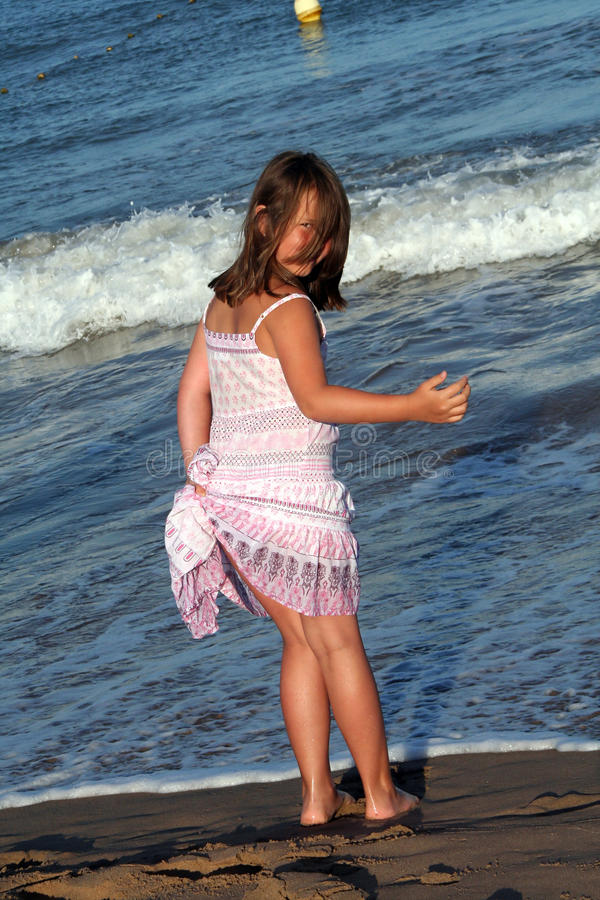 Download Little girl on the beach stock photo. Image of fashion - 21574578