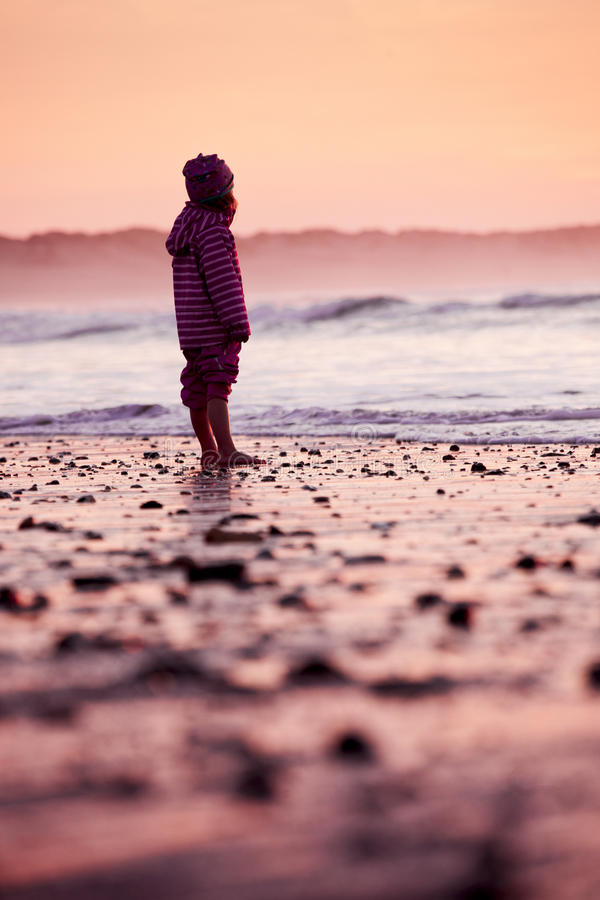 Little girl in the beach stock images