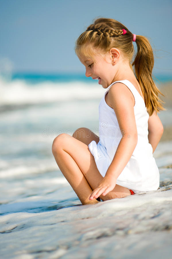 Little girl on the beach royalty free stock images