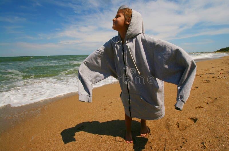 Little girl on beach stock photo