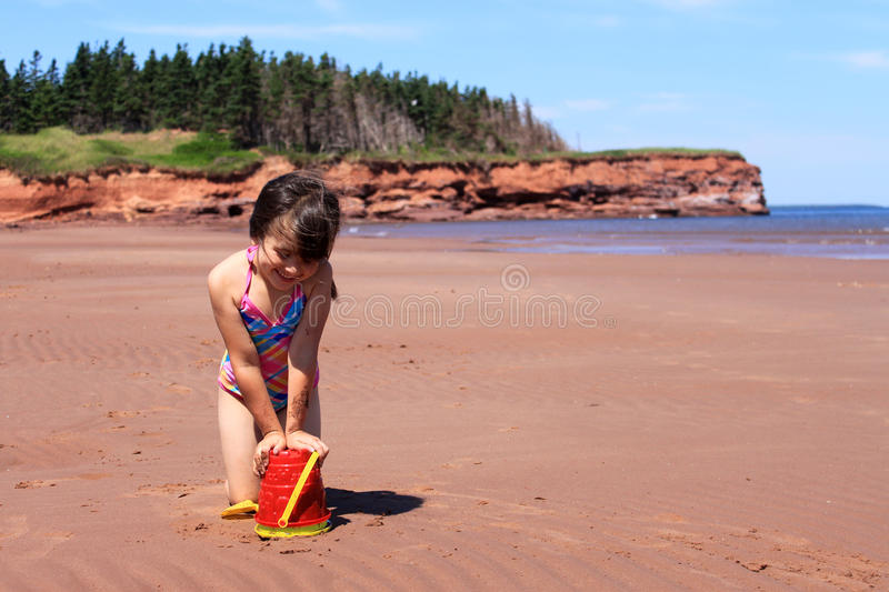 Little girl at the beach in P.E.I stock photo