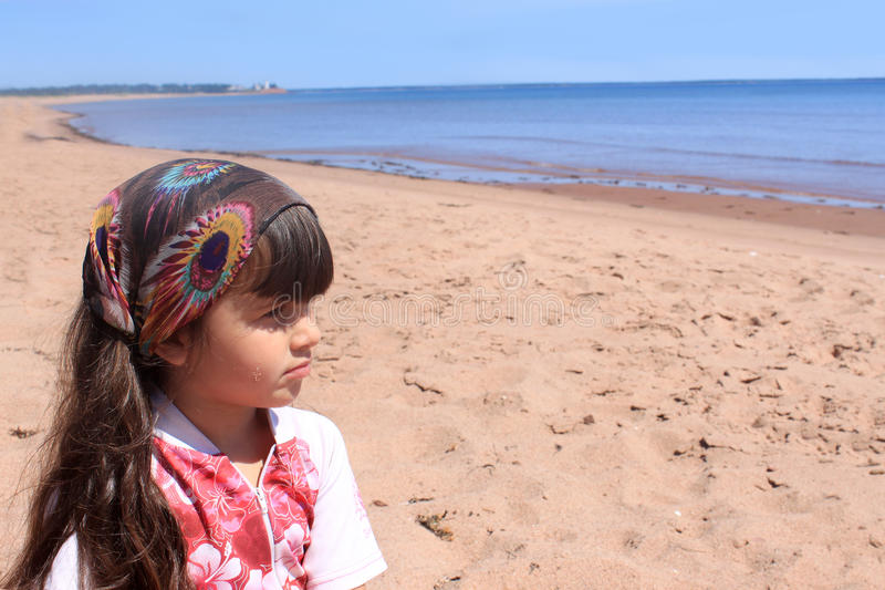 Little girl at the beach in P.E.I royalty free stock photo