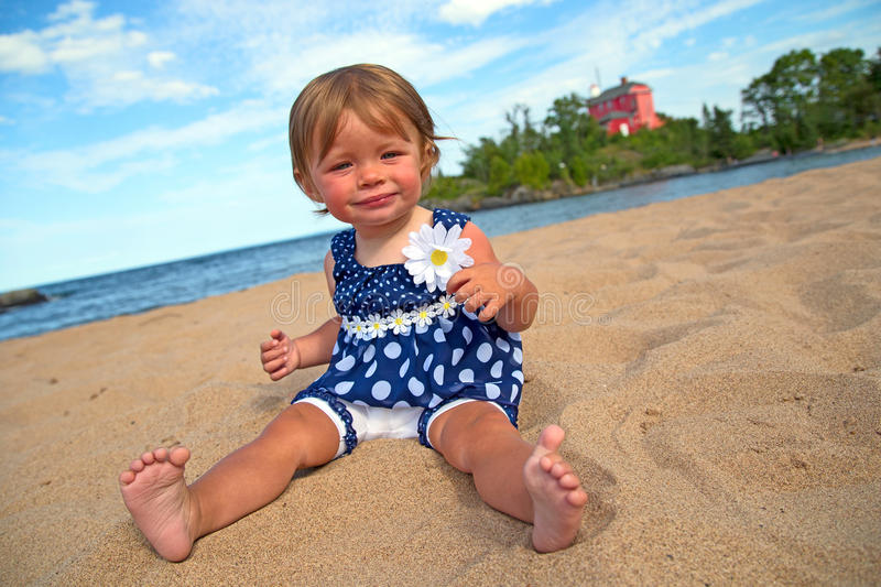Little girl at the beach royalty free stock images