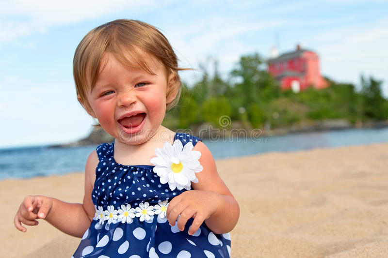 Little girl at the beach royalty free stock photo