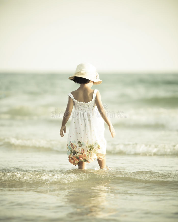 Little girl on beach vacation royalty free stock photo
