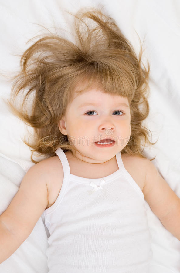 Little girl in a bed royalty free stock photo