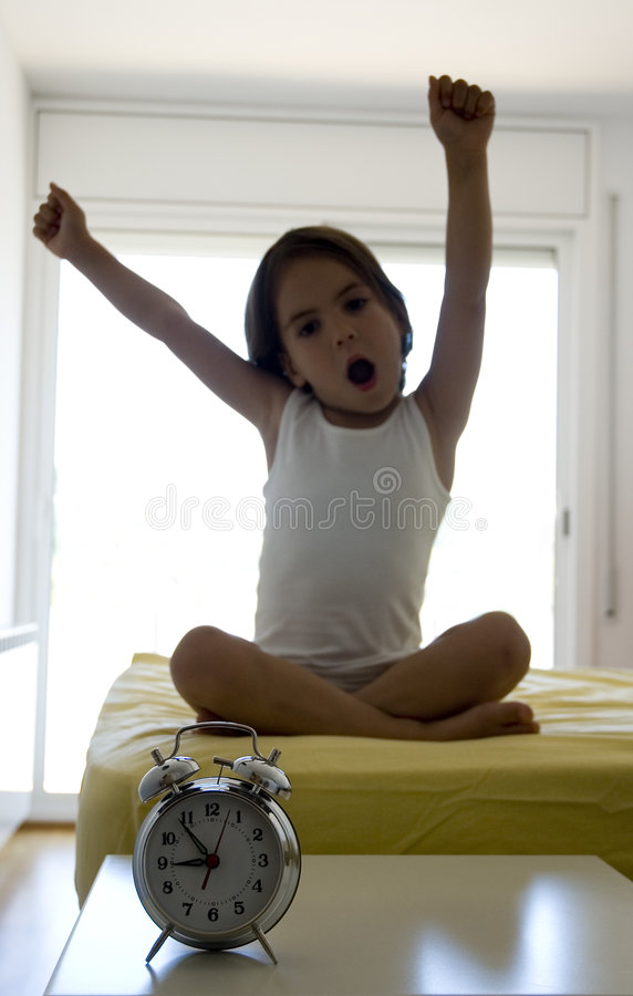 Little girl on the bed royalty free stock images