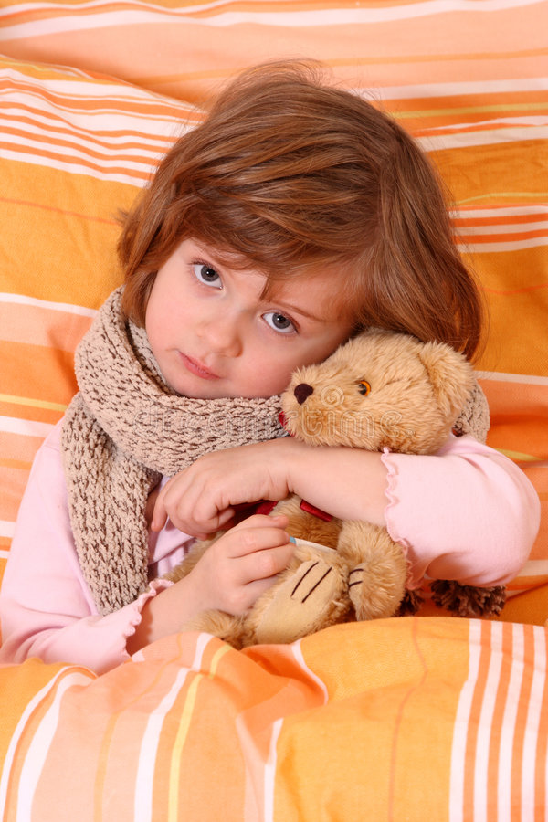 Little girl in bed stock images