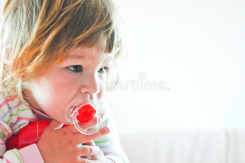 Download Little Girl In Bed With Red Pacifier Stock Photo - Image: 23850350