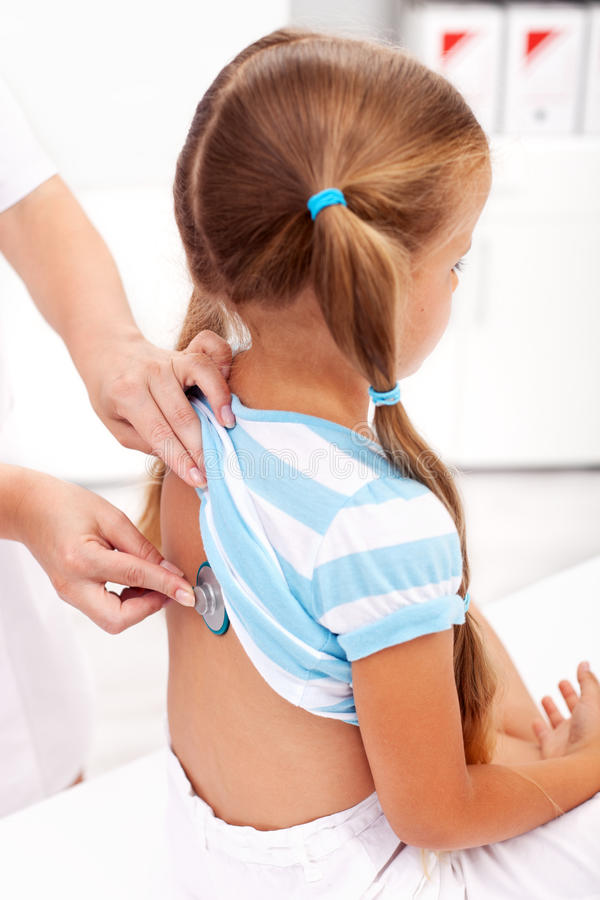 Little Girl Being Checked At The Doctor Royalty Free Stock Images