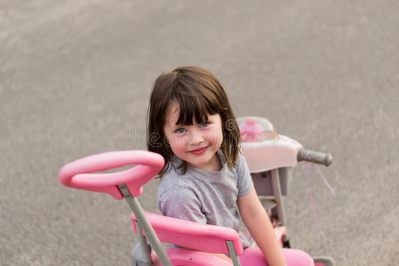 Little girl on a bicycle royalty free stock photo