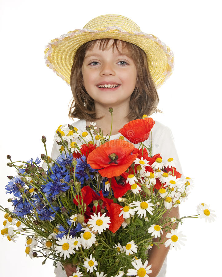 Little girl with big bouquet of wild flowers stock photography