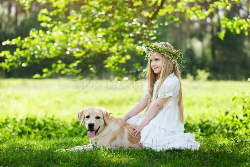 LIttle girl and big dog bestfriend on nature background royalty free stock images