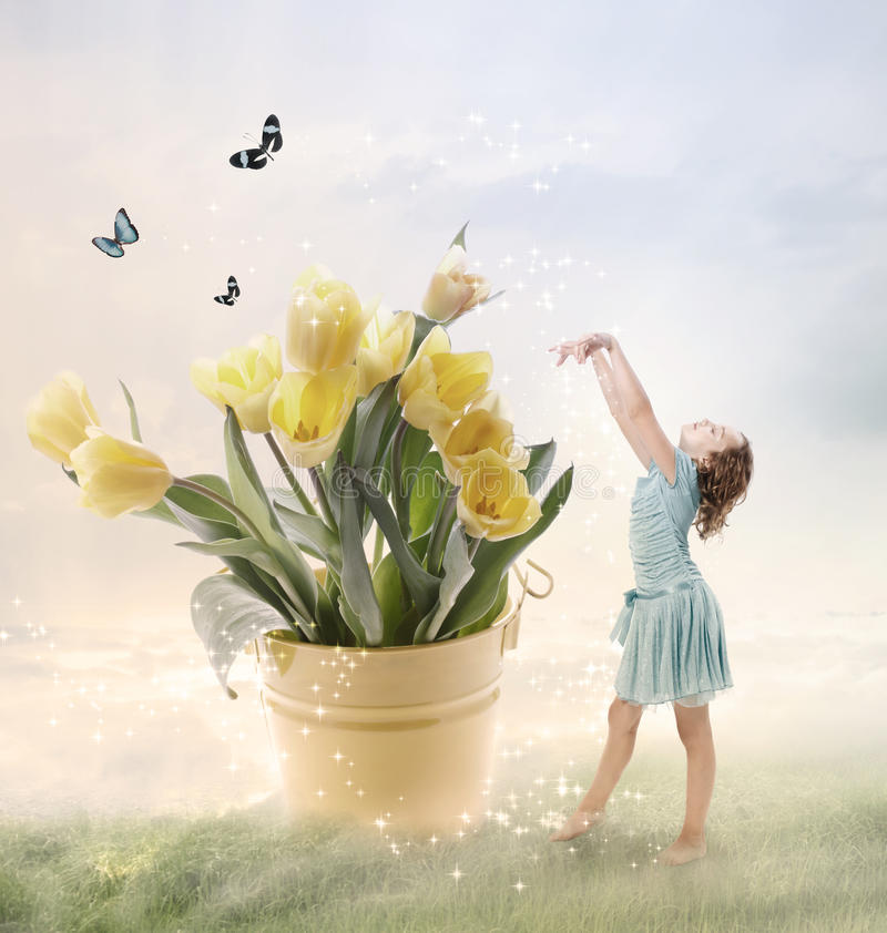 Little Girl with Big Flowers stock photos