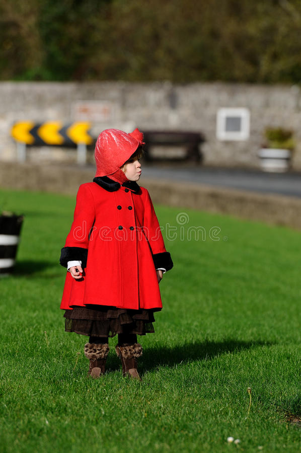 Little Girl. A little girl in a big red coat royalty free stock images
