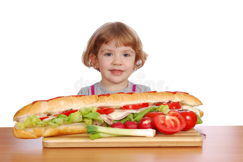 Little girl with big sandwich stock photo