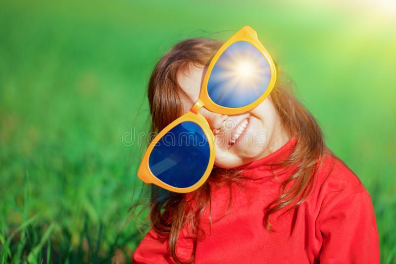 Little girl with big sunglasses royalty free stock photography